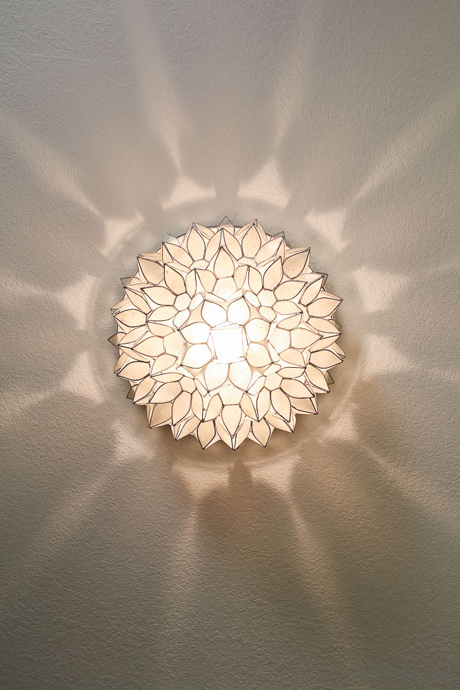 Shell capiz ceiling light fixture - reflections and pattern on ceiling at night