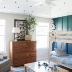 Blue green board and batten wall in boys' shared room