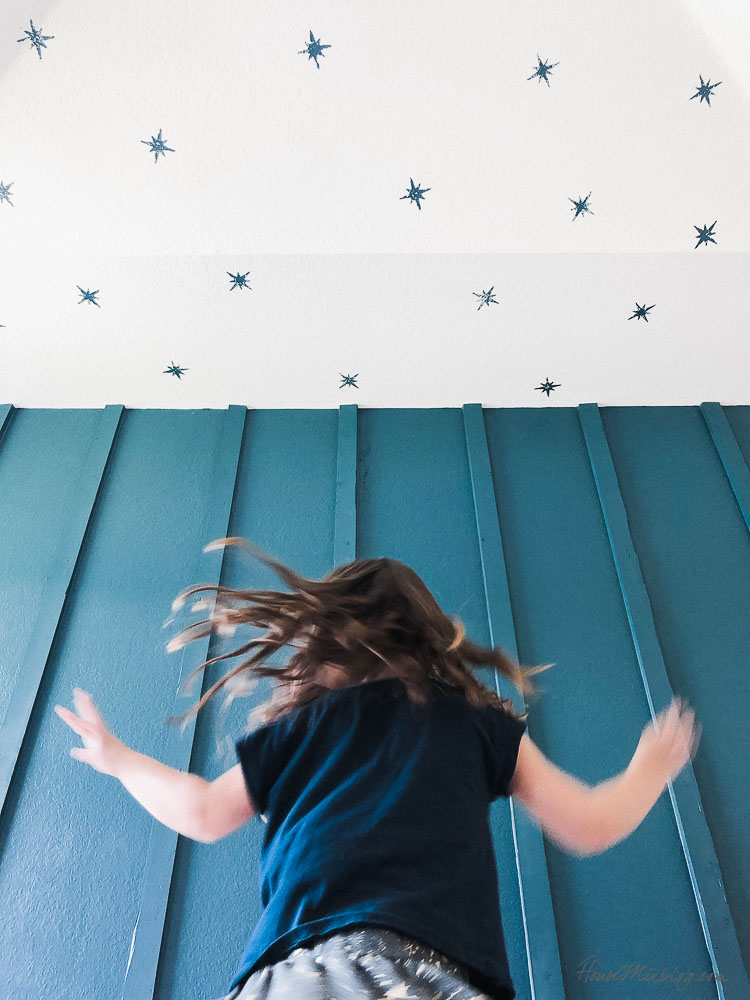 Teal board and batten wall accent wall with star stamped ceiling