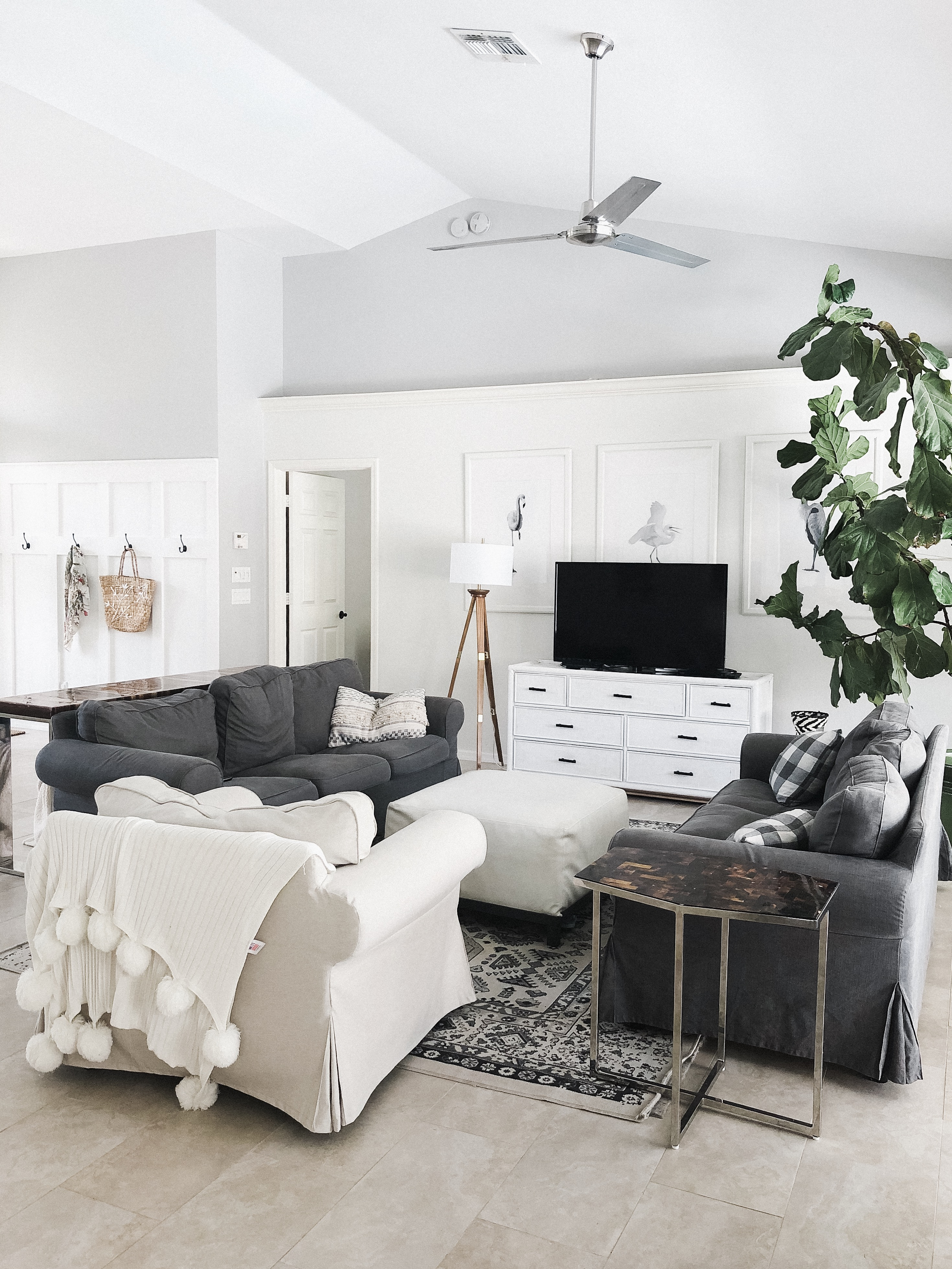White and gray living room with board and batten wall