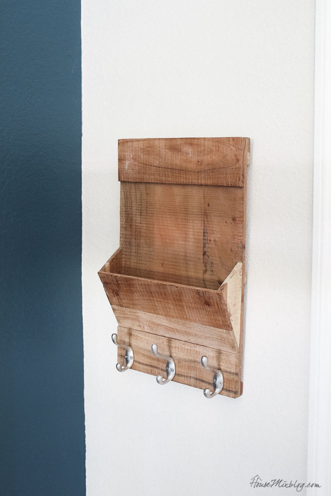 Wooden shelf with hooks for kids backpacks and special place to keep library books