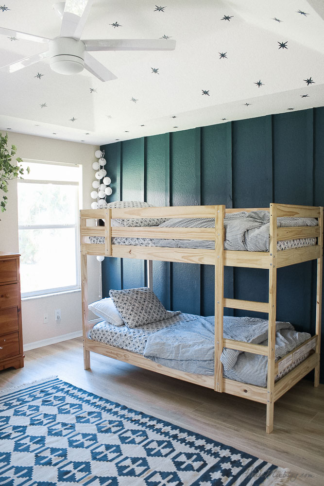 boys shared room with peacock green board and batten wall and bunkbeds
