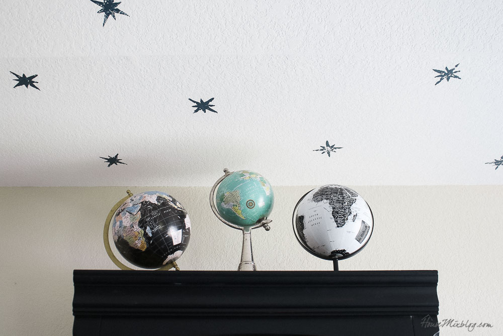 globes on bookshelf - styling for boys room - star stamped ceiling