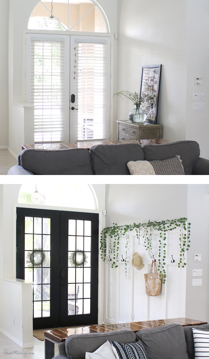 Front-entry-makeover-with-door-painted-black-and-inexpensive-DIY-board-and-batten-wall