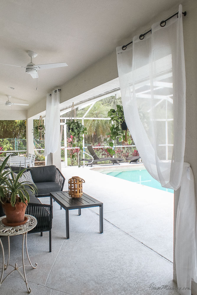 Patio, pool and lanai decor ideas on a budget-curtains and plants make a patio into a private resort