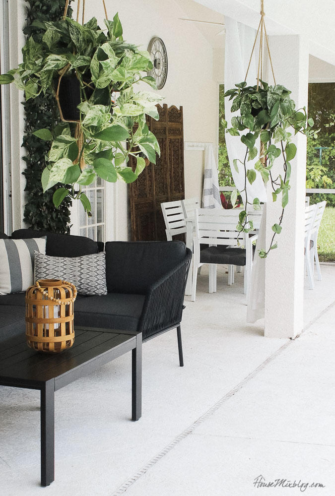 Patio, pool and lanai decor ideas on a budget- hanging plants add life to boring patio