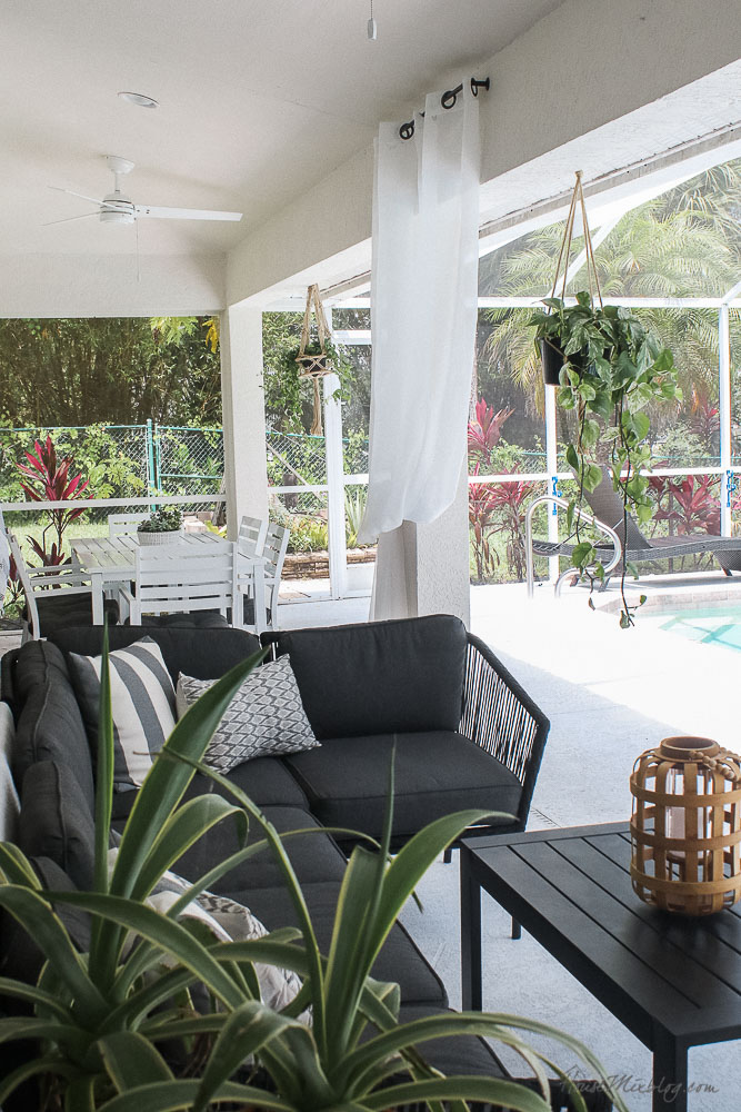 Patio, pool and lanai decor ideas on a budget- hanging plants and curtains