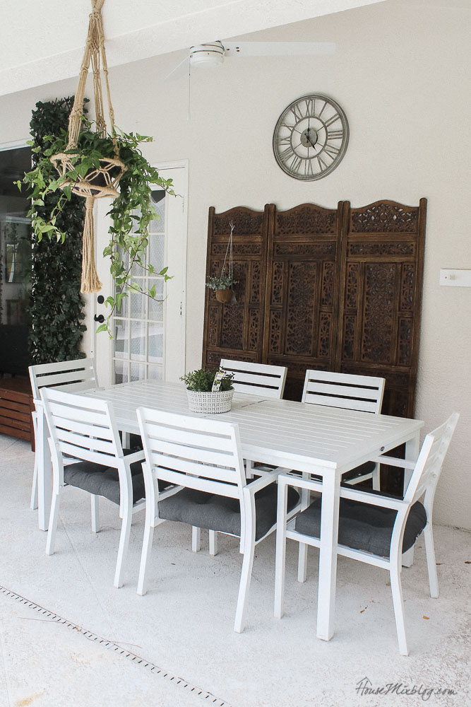 Patio, pool and lanai decor ideas on a budget-inexpensive outdoor dining set and wooden screen and clock