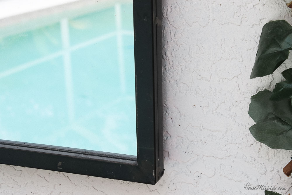 Patio, pool and lanai decor ideas on a budget- large outdoor iron mirror