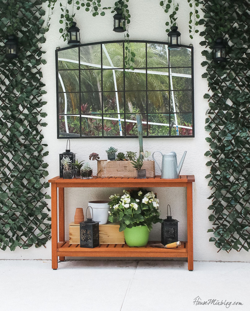 Patio, pool and lanai decor ideas on a budget- outdoor decor ideas - mirror, lanterns, faux greenery and console table