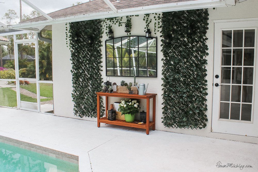 Patio, pool and lanai decor ideas on a budget- outdoor furniture on a budget - mirror, lanterns, faux greenery and outdoor table
