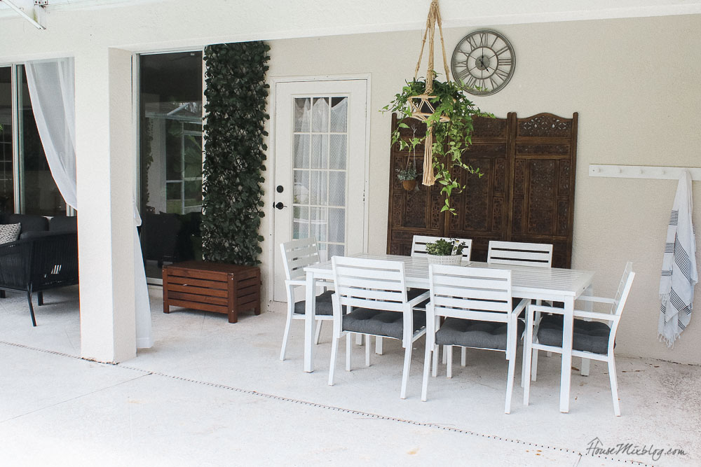 Patio, pool and lanai decor ideas on a budget-white outdoor dining table and chairs with wooden screen