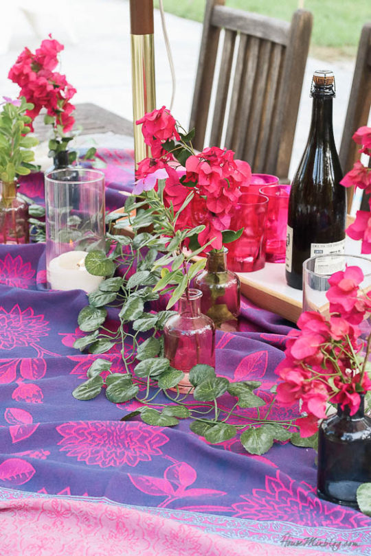 Table setting outside - Outdoor dining in hot pink and purple- bougainvillea and tapestry tablecloth