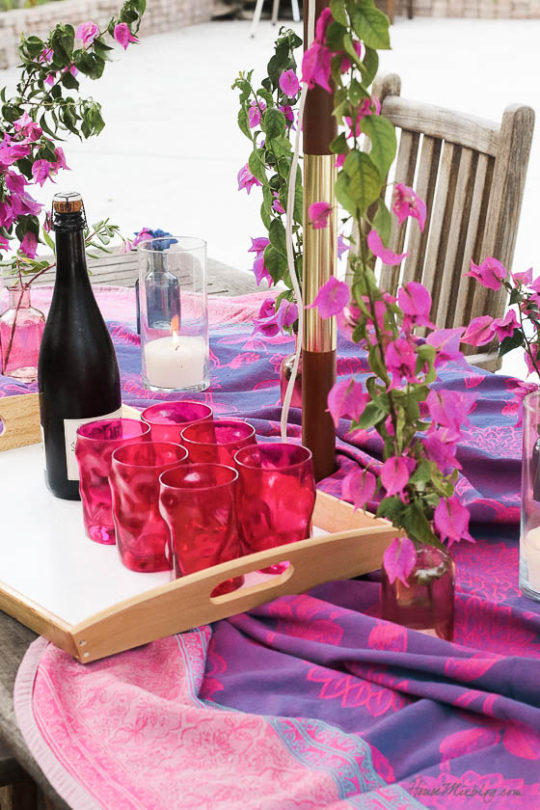 Table setting outside - Outdoor dining in hot pink and purple-bougainvillea clippings