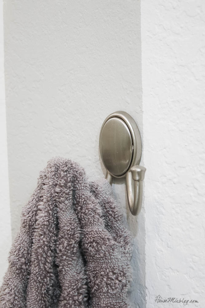 Silver shower hook for towels