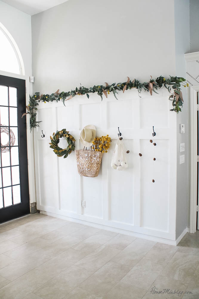 Board and batten wall with hooks decorated for fall - fall styling ideas for hooks and entry