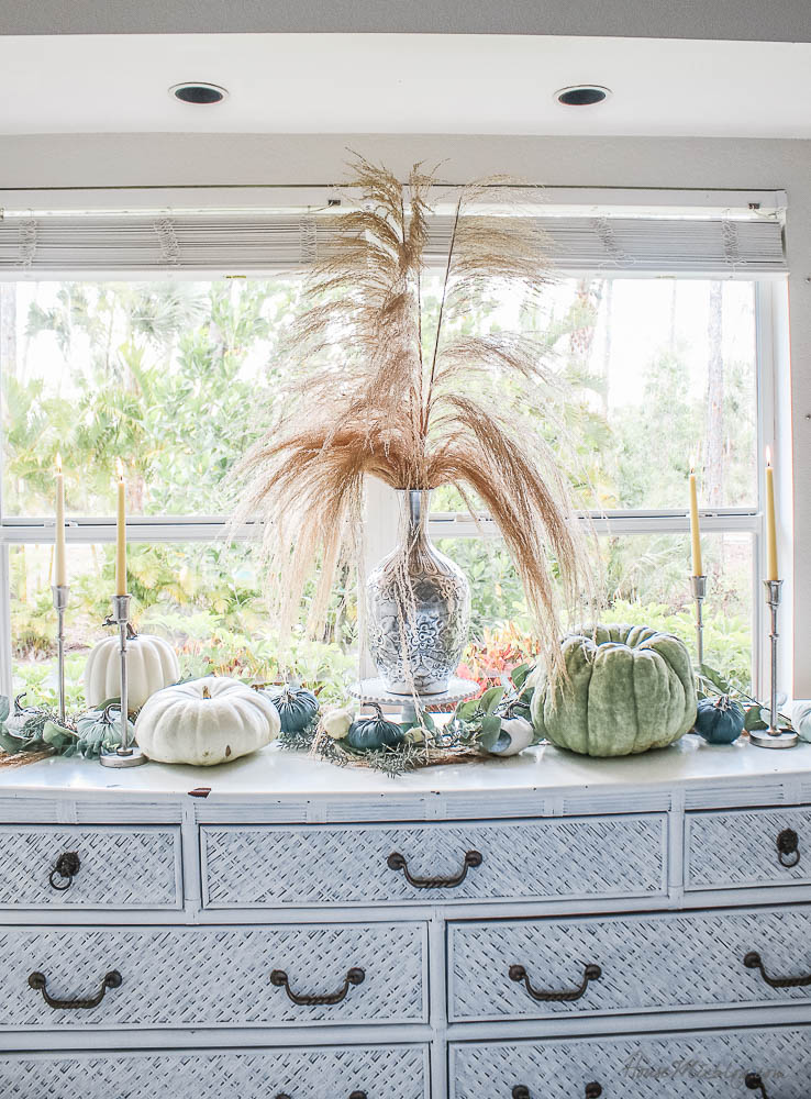 Neutral fall decor - buffet table green sage pumpkins silver candles pompas grass heirloom pumpkins thanksgiving table setting autumn