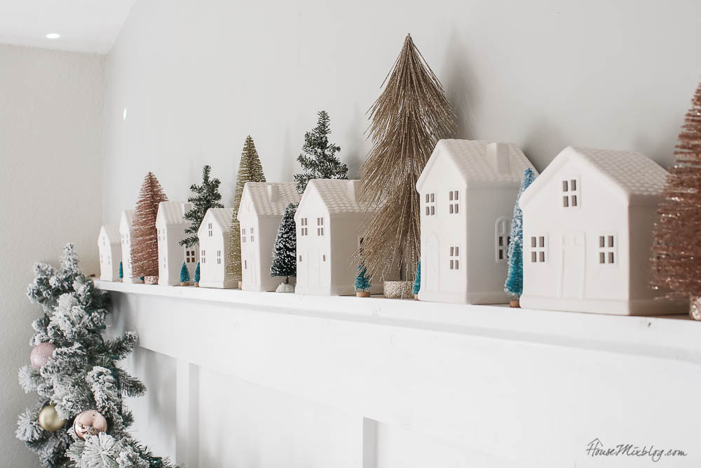 Christmas decor - blush and gold - holiday home tour - dining room Christmas decor with bottle brush trees, white houses and flocked garland
