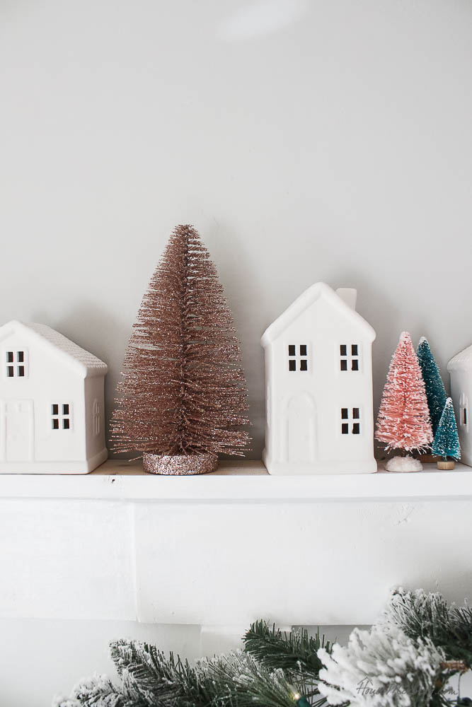 Christmas decor - blush and gold - holiday home tour - dining room Christmas decor with flocked tree, garland and wreaths from walmart  - bottle brush trees and white houses