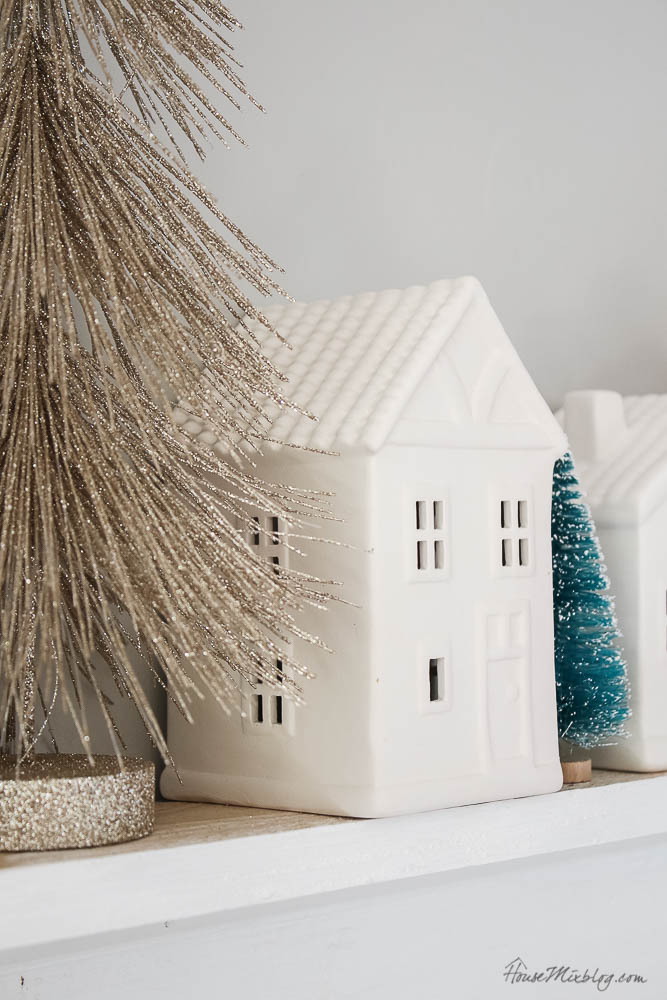 Christmas decor - blush and gold - holiday home tour - dining room Christmas decor with bottle brush trees and white houses and remote tea candles