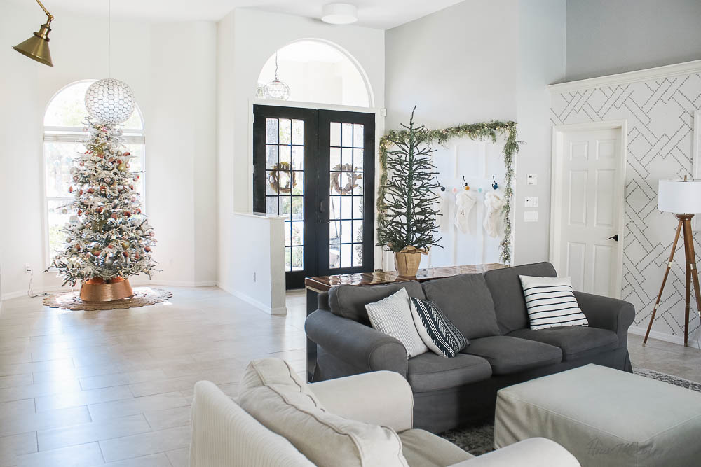 - Christmas decor - blush and gold - holiday home tour - board and batten wall with stockings and garland