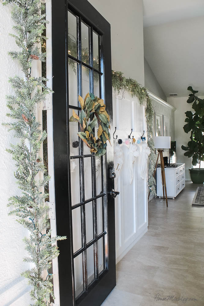 - Christmas decor - blush and gold - holiday home tour - board and batten wall with stockings and garland - black french doors