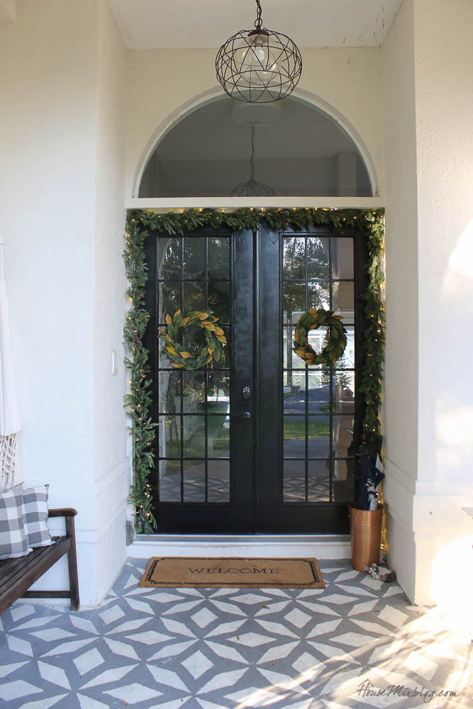 - Christmas decor - blush and gold - holiday home tour - front door with garland and lights - black french doors - outdoor christmas decorations