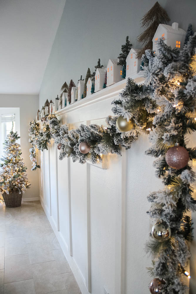 Christmas decor - lights and little white houses that light up, flocked garland, gold and blush