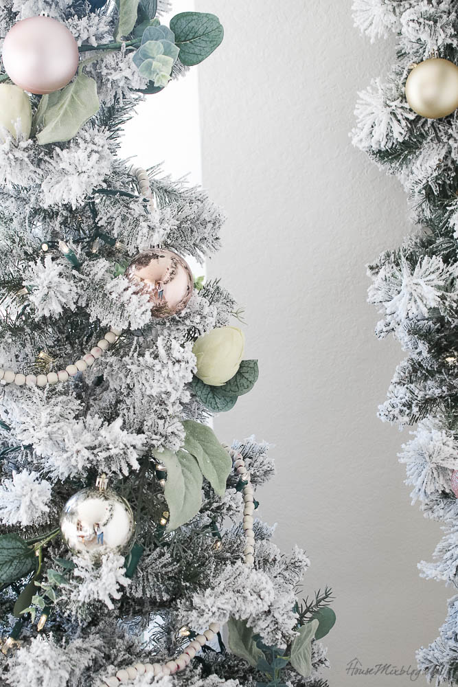 Christmas decor - blush and gold - holiday home tour - dining room Christmas decor with flocked tree, garland and wreaths from walmart - $81