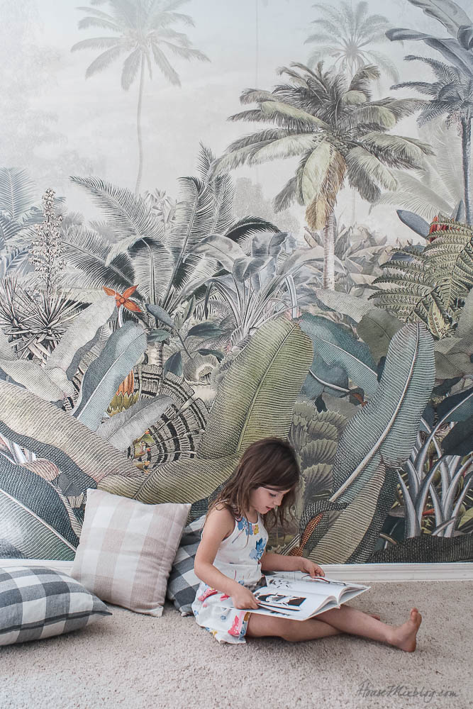 Sage play room with Amazonia tropical wallpaper mural in green, gray and coral