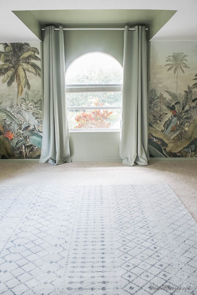 Sage playroom with tropical jungle mural and $140 gray and cream rug 8x10