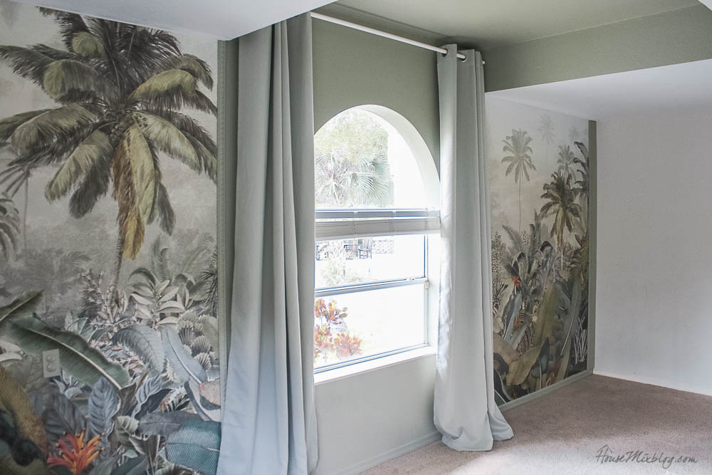 Sage playroom with tropical jungle mural and chalkboard wall with sage blackout curtains