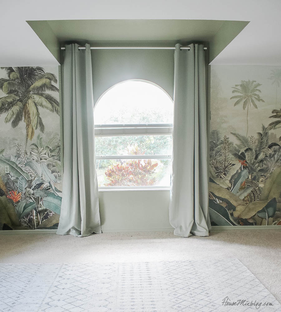 Sage playroom with tropical jungle mural and chalkboard wall with movie projector and wall. Benjamin Moore sage wisdom paint color