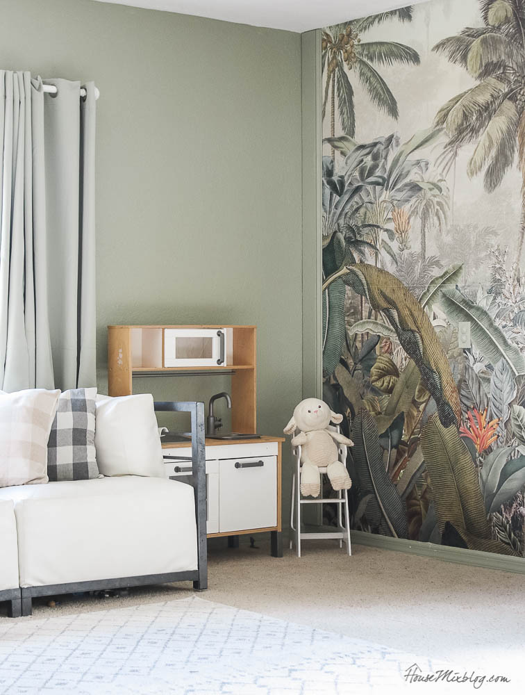 Sage playroom with tropical jungle mural, sage curtains, Amazonia mural, Ikea kids play kitchen, Benjamin Moore sage wisdom paint color