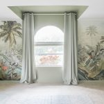 Sage playroom with tropical mural