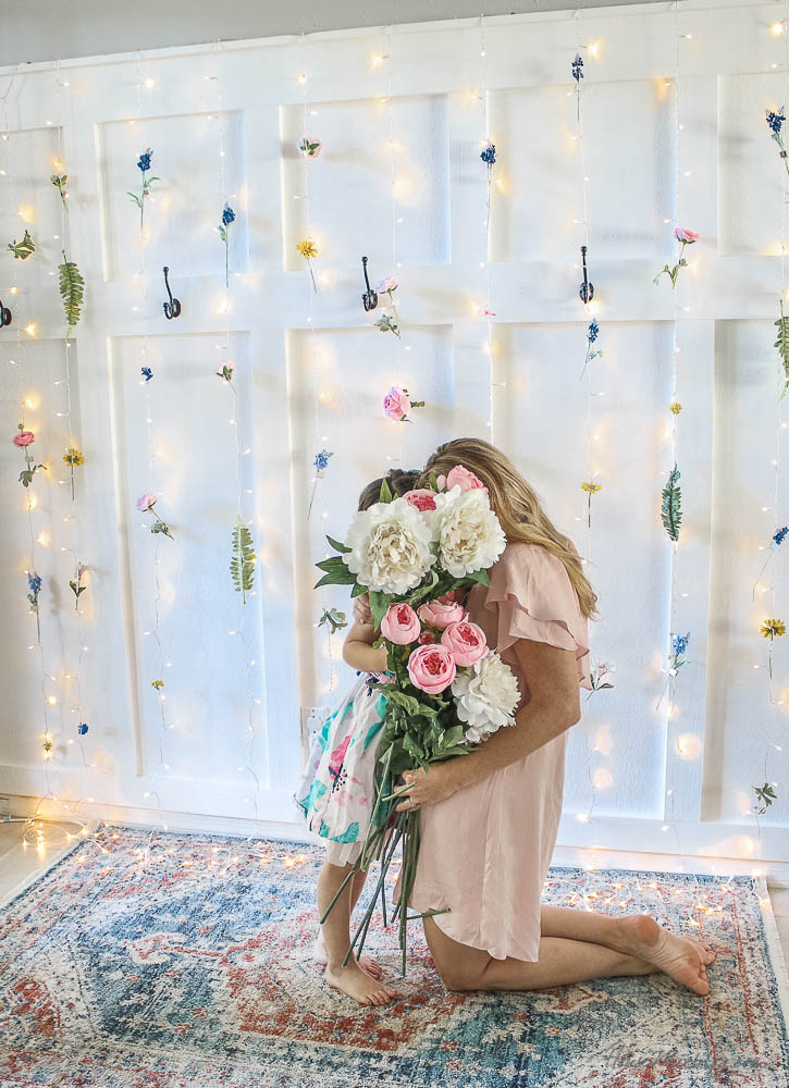 Flower wall with twinkle light curtain - Spring decor ideas, photo backdrop ideas, wedding, baby shower, DIY