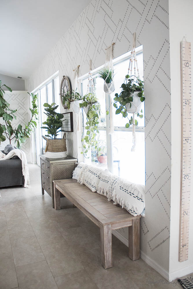Stenciled living room - wallpaper alternative, Light French Gray, how to stencil, white walls, gray couches, colorful rug, big fiddle leaf fig tree, wooden accent table, hanging plants, ektorp ikea-18