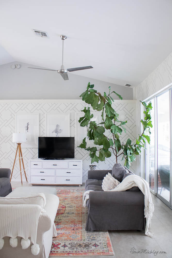 Stenciled living room - wallpaper alternative, Light French Gray, how to stencil, white walls, gray couches, colorful rug, big fiddle leaf fig tree, wooden accent table, hanging plants, ektorp ikea