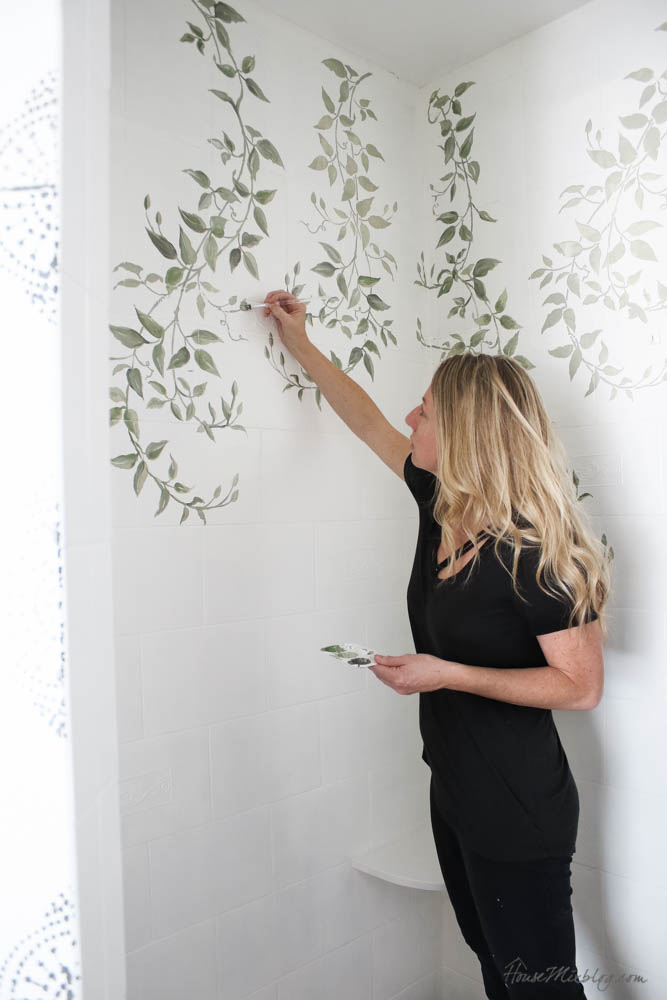 Stenciling on shower tile - how to make a stencil look handpainted - green leaves in shower