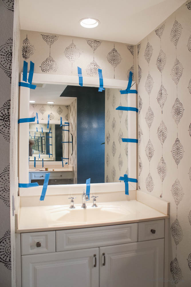 How to frame a bathroom builder grade mirror - Frame attached to mirror with Liquid Nails glue