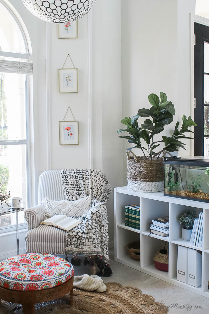 White reading nook with moulding and Ikea bookshelves - library with bookcases and plants