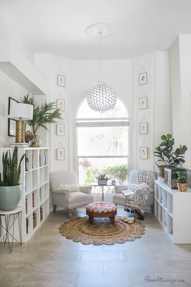 white reading nook with ikea shelves, fancy corners trim moulding and plants