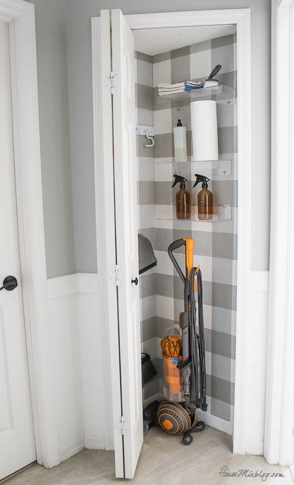 Organize cleaning products - vacuum, swiffer, spray bottles, buffalo check wallpaper, cleaner, closet, cabinet