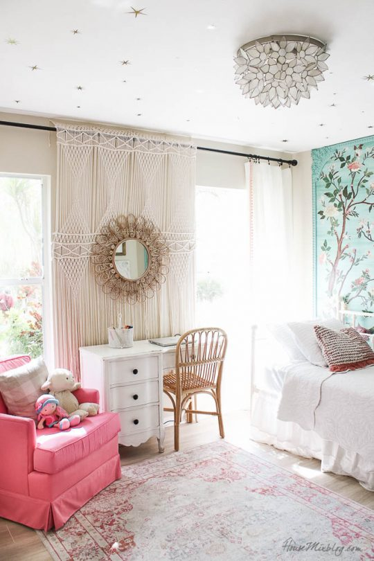 Girls bedroom with green chinoiserie mural, white daybed, shelves, desk and macrame tapestry