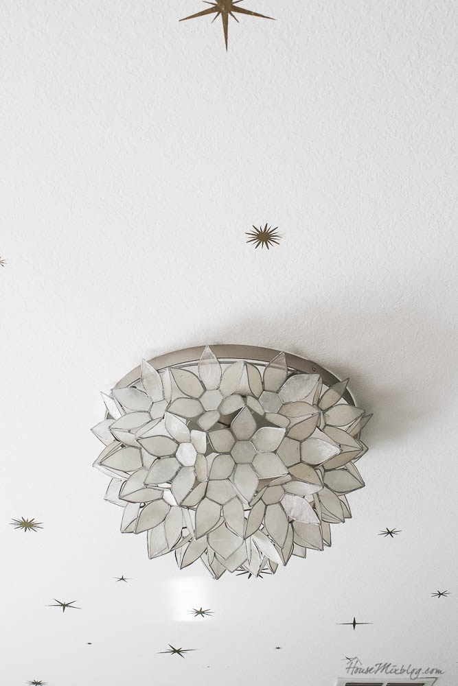 gold star decals on ceiling with capiz flush mount light fixture