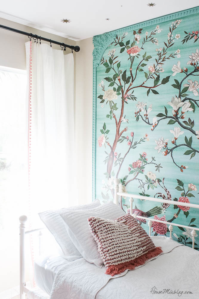 Girls bedroom with green chinoiserie mural, white daybed, shelves, desk and macramé tapestry