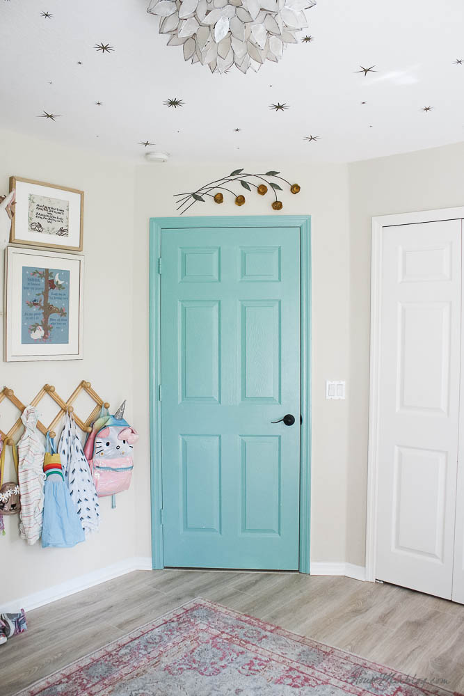 Painted green door in kids room