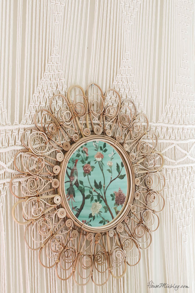 rattan peacock circle mirror with macrame tapestry curtain behind-1