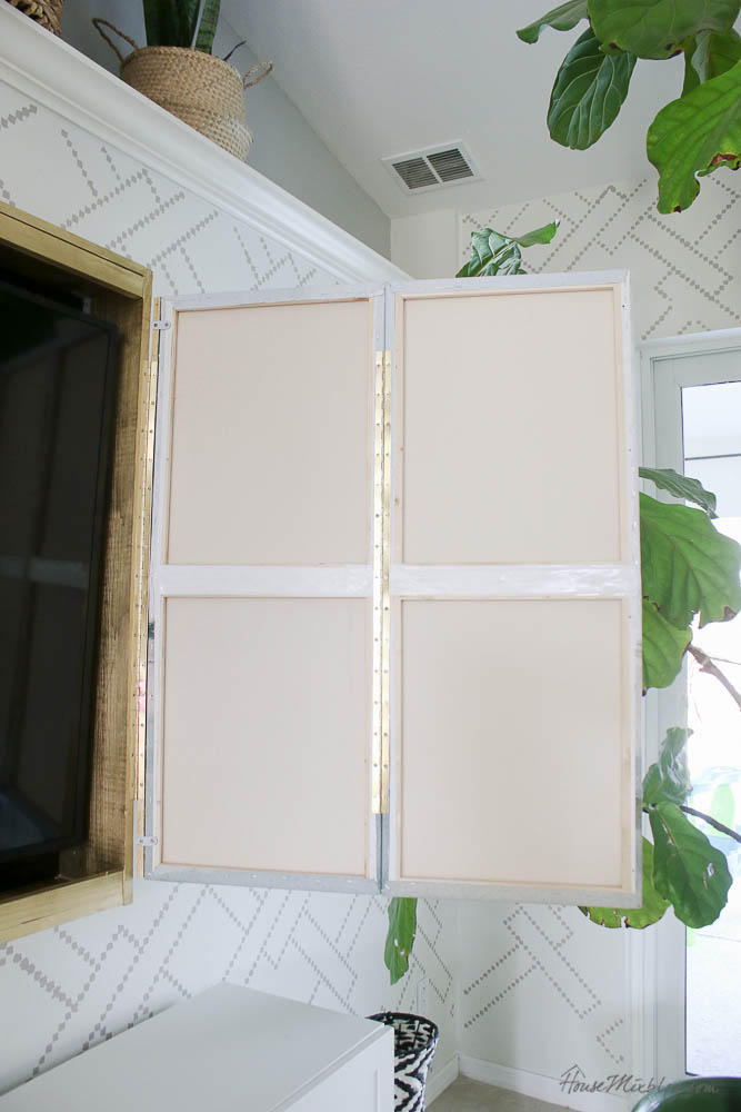Hidden tv - DIY tv frame with art - ideas how to hide the tv - how to build a simple frame - piano hinges and canvases