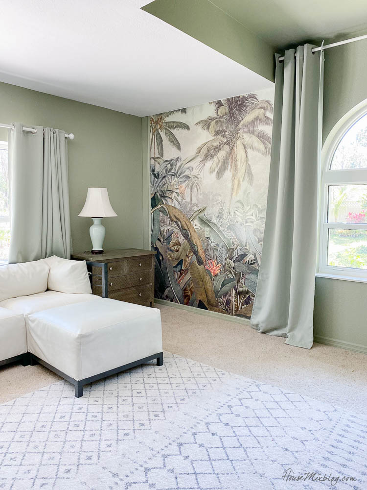 Sage playroom with tropical mural and movie projector